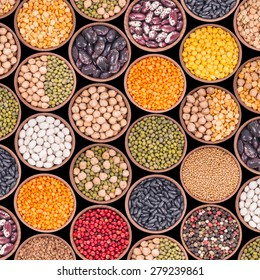 Seamless texture with legumes on black background