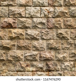 Seamless texture of medieval stone wall. Gothic masonry work made of old bricks and antique stones. Ready to be used in games and 3d modelling.