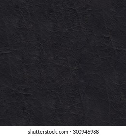 Seamless texture of natural black thick leather.