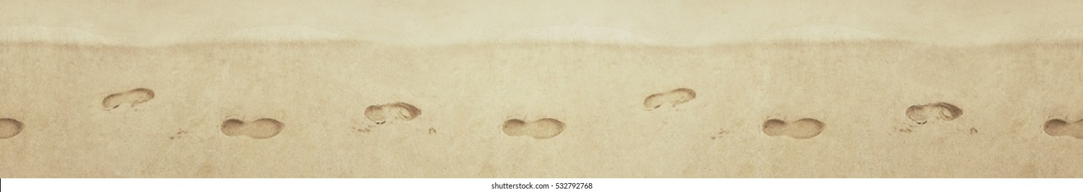 Seamless texture. Pattern. Footprints in the sand. Traces of shoes on  sandy shore