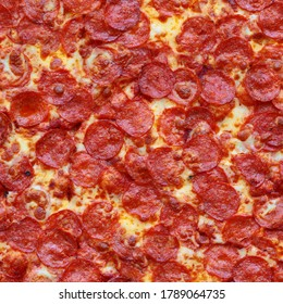 Seamless texture of Pepperoni Pizza. Pisa. Tuscany. Italy.