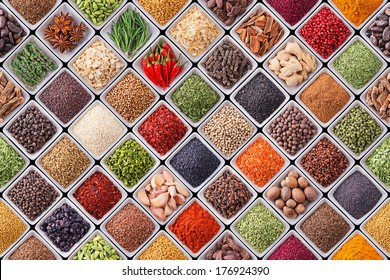 Seamless texture with spices and herbs over black background