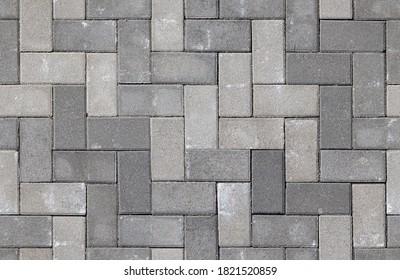 Seamless texture of street tiles. Pattern of gray sidewalk tiles