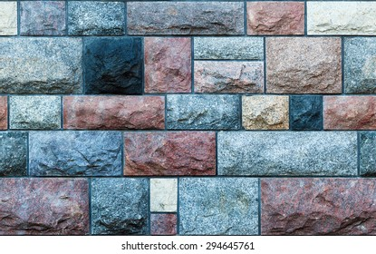 Seamless texture of a wall made of colorful stone blocks. Background.