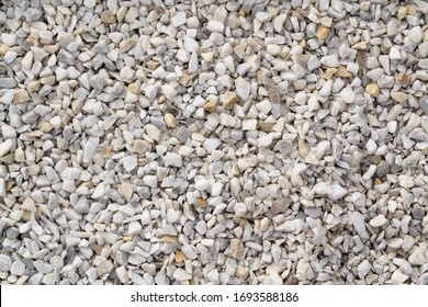 Seamless texture of white stones or gravel. Road gravel, crushed stone. Gravel texture. Crack stones at a construction site.