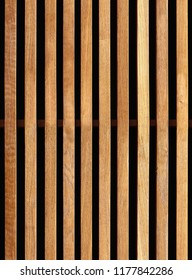 Seamless texture of wooden decorative battens placed vertically on facade of building. New York. USA.