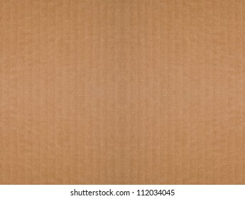 Seamless, tileable, brown, corrugated cardboard background. Recycled material.