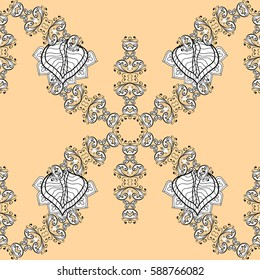 Seamless vintage pattern on beige background with golden elements and with white doodles. Christmas, snowflake, new year.