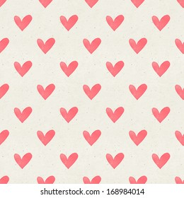 Seamless watercolor heart pattern on paper texture. Valentine's day background