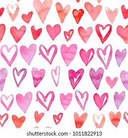 Seamless watercolor pattern with colorful hearts. Bright tints of pink and red. Hand-painted romantic texture for Valentine's Day, packaging, wedding, birthday
