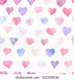 Seamless watercolor pattern with colorful hearts. Light and soft tints of pink, red, blue, purple. Hand-painted romantic texture for Valentine's Day, packaging, wedding, birthday