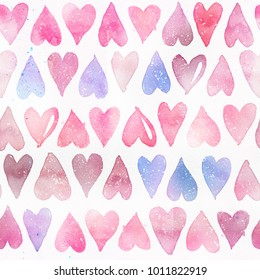 Seamless watercolor pattern with pink hearts. Light and soft tints of pink, purple and blue. Hand-painted romantic texture for Valentine's Day, packaging, wedding, birthday