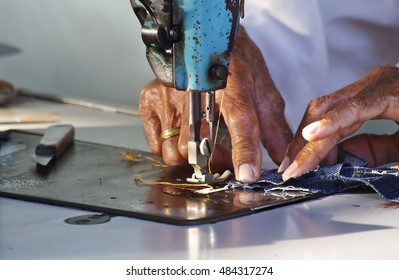 seamstress with old sewing machine