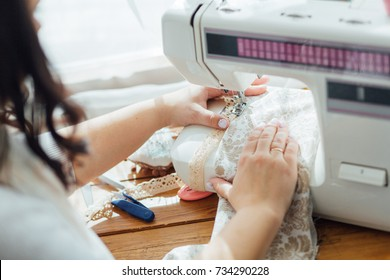 A seamstress with the sewing machine