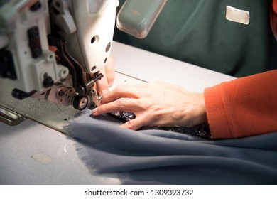 Seamstress sews garments luxury made in italy