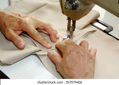 Seamstress using Sewing Machine hands focus