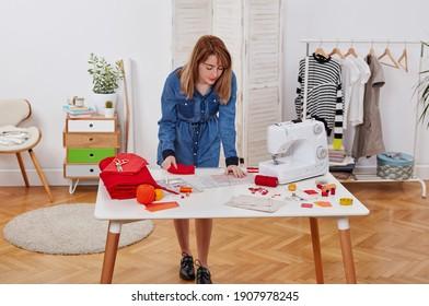 Seamstress woman in workshop standing