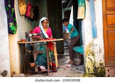 Seamstress working in the Muslim neighborhood of Agra. Agra India. November 2019