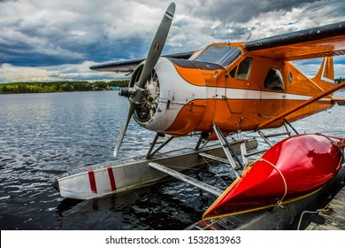 Seaplane and canoe waiting to take off.  Vintage aircraft