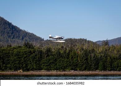 Seaplane / Float plane flying over the water in Ketchikan, Alaska.