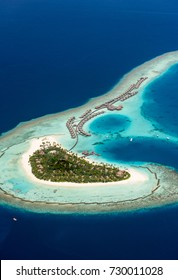Seaplane fly over atoll in Maldives