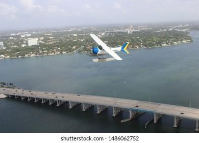 Seaplane flying over Miami causeway bridge flown by Miami Seaplane Tours on August 17, 2019.