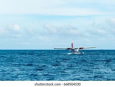 seaplane landing in the ocean