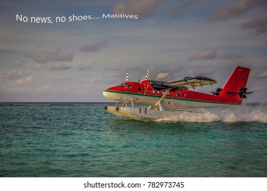 Seaplane landing in the ocean lagoon. The takeoff of a seaplane from the ocean beach. No news, no shoes... Maldives. Motivation photo