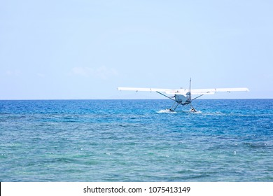 seaplane landing on water, copy space on left