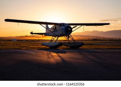 Seaplane parked at the airport during a vibrant summer sunset. Taken in Pitt Meadows, Greater Vancouver, BC, Canada.