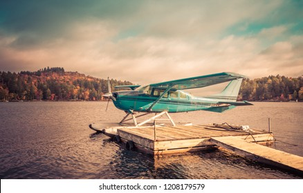 Seaplanes docked at the shore in Long Lake, NY,  awaiting leaf-peepers and adventure seekers, retro split tone