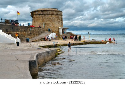 SEAPOINT, IRELAND - AUGUST 3: Leisure activity at Seapoint's Martello Tower No. 14, a Napoleonic-era coastal defence fort on August 3, 2013 in Dun Laoghaire, Ireland