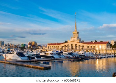 Seaport with mooring boats at sunset in Sochi, Russia
