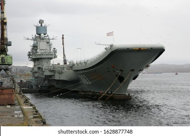 Seaport of Murmansk, Russia - September 17, 2011:  Admiral Flota Sovetskogo Soyuza Kuznetsov, the aircraft carrier (aircraft cruiser in Russian classification) moored during minor repair works