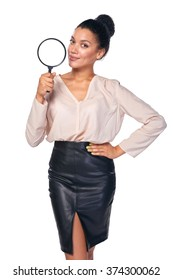 Search concept. Confident business woman standing holding magnifying glass, isolated over white