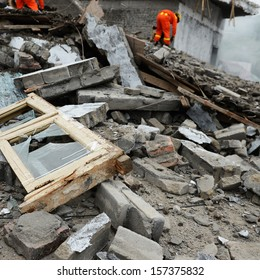 Search and rescue forces search through a destroyed building.
