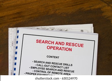 Search and Rescue Operation  training manual with blueprints in a wood texture background.