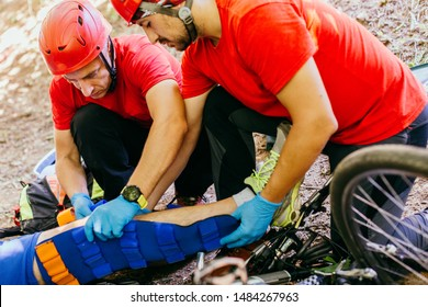 Search and rescue team helping injured  bicyclist