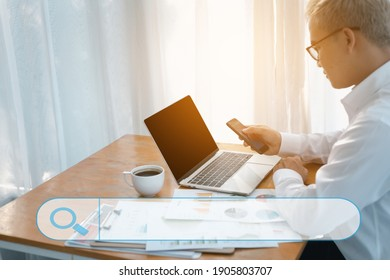 Searching browsing internet Data information with blank search bar. A businessman making notes, working with smart phone, tablet and laptop computer on desk in office. Networking concept