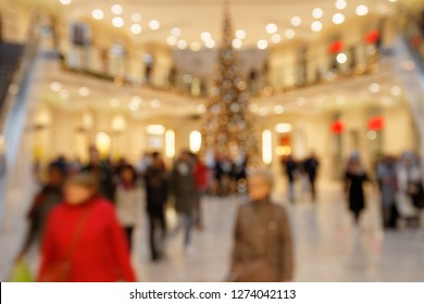 Searching for Christmas Gifts: Blurred Scene with hurrying Pedestrians in highly frequented Shopping Mall