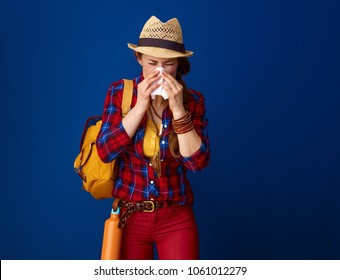 Searching for inspiring places. ill traveller woman in a plaid shirt blowing nose against blue background