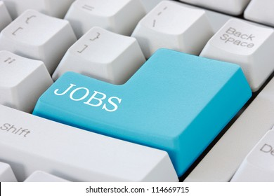 Searching for job on the internet. Jobs button on computer keyboard .
