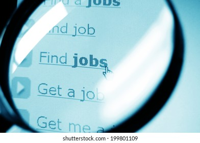 Searching for jobs concept with computer screen and magnifying glass
