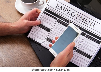 Searching for a new job or employment in a newspaper