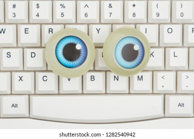 Searching on the Internet, A close-up of a keyboard a large set of googly eyes