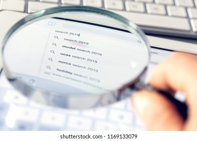 Searching online using a magnifying glass. Search in 2019 years.