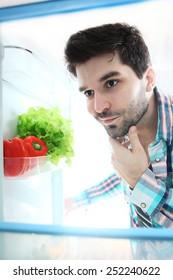 Searching something in refrigerator