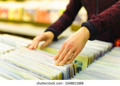 Searching through the records at a vintage vinyl shop
