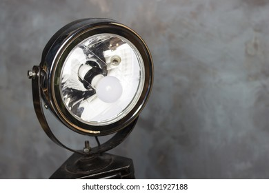 Searchlight on wooden legs. Vintage searchlight. Old floodlight