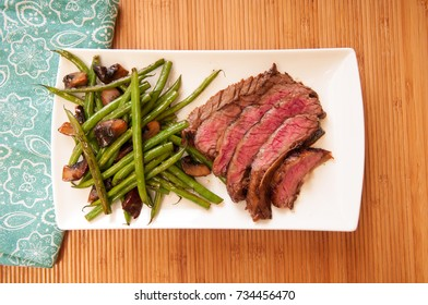 seared flank steak with green beans and mushrooms, a ketogenic diet meal